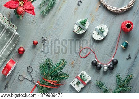Xmas Background With Christmas Tree Fir Twigs, Gift Boxes And Decorations, Trinkets, Baubles In Red,