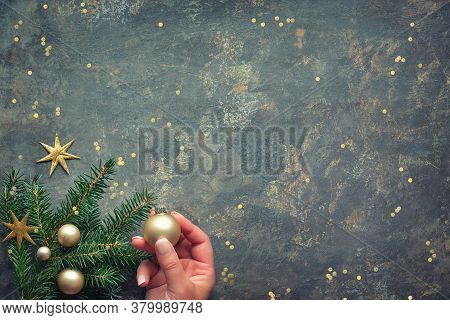 Christmas Decorations, Flat Lay With Hands Holding Fir Twigs Decorated With Golden Toys. Flat Lay, T