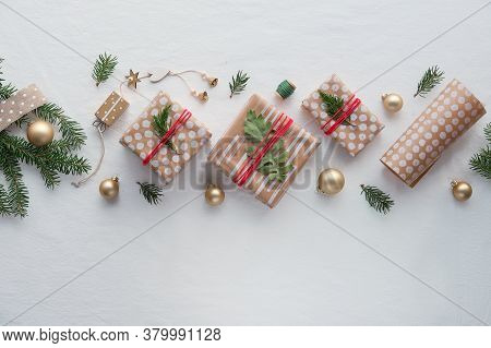 Diy Christmas Gifts In Craft Wrapping Paper, Handmade Decorations. Flat Lay On White Soft Textile Ba