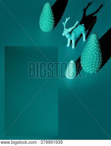 Trendy Isometric Christmas Arrangement With Copy-space. Ceramic Deer And Xmas Trees Toned In Cyan Mo