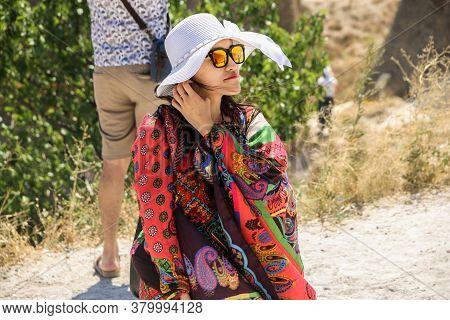 Cappadocia, Turkey April 14, 2019: Beautiful Girl Wearing A Folk Costume In Cappadocia.