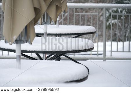 Close Up On Garden Patio Table After Snow