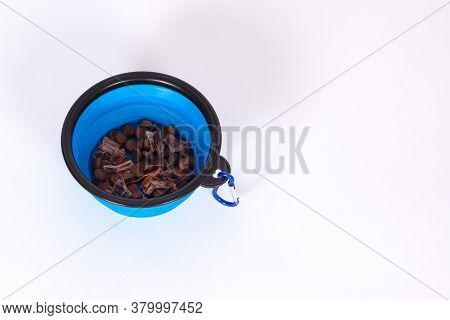 Little Plastic Dog Bowl With Some Dry Food, Carabiner Clasp For Backling Up To The Belt, Allowing To