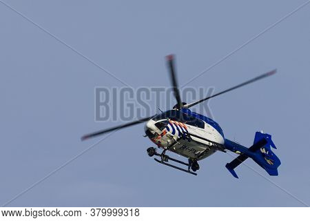 Kampen Netherlands May 26 2020: Dutch Police Helicopter Flying By Searching For Suspected Criminals