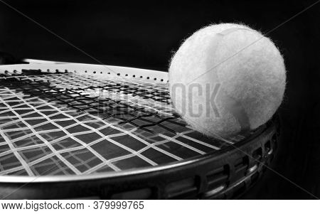 Tennis Ball And Racket In Black And White..