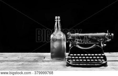 Antique Portable Typewritter Made In 1917 With Whisky Bottle With Room For Your Type In Black And Wh
