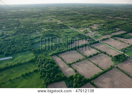 Aerial View Of A Green Rural Area Under A Long Horizon.
