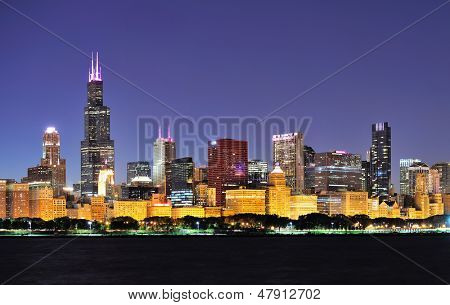 Chicago city downtown urban skyline panorama at dusk with skyscrapers over Lake Michigan with clear blue sky. poster