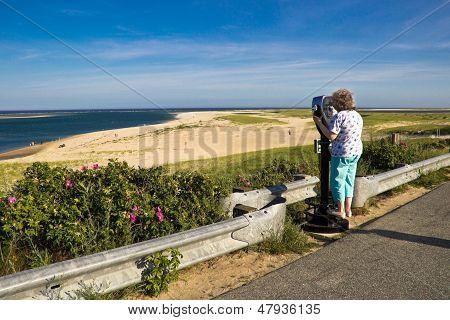 Sight-seeing Woman At A Cape Cod Beach