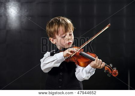 Freckled Red-hair Boy Playing Violin.