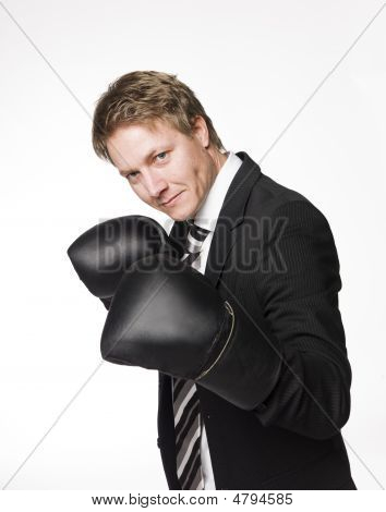 Businessman in boxinggloves and tie towards white background poster
