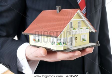 businessman showing a model house poster