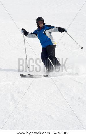 Female Skier On Ski Trail, Cloud Of Powder Snow