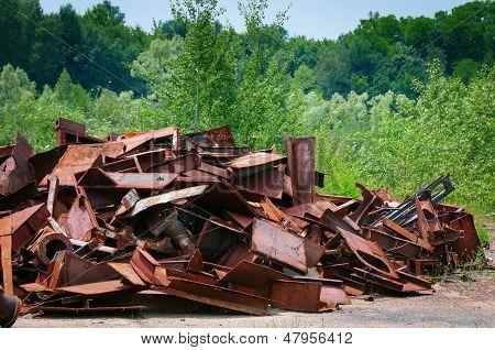 Metal Garbage In Green Nature
