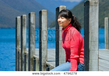 A Girl Sitting By The Lake