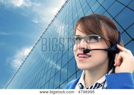 Business Girl With Glass Office And Headset