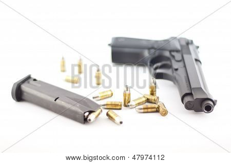 Pistol with bullet isolated.