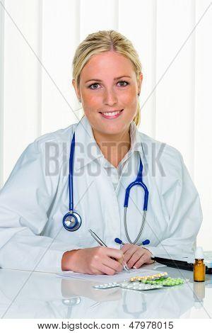 a young doctor prescribes medication. prescription pills are prescribed by a doctor.
