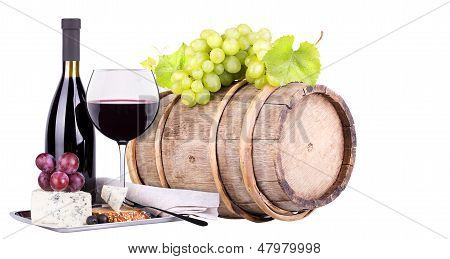 grapes on a barrel, wine  and cheese