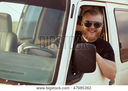 Smiling Driver Driving A Car