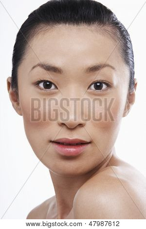 Closeup portrait of beautiful young Asian woman on white background