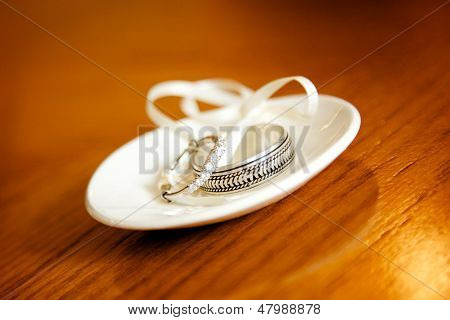 Wedding Rings on a white dish