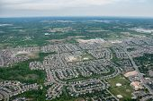 Aerial view over a residential suburb neighbourhood. poster