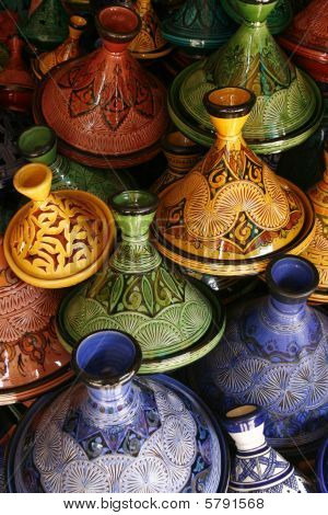 Selection of very colorful Moroccan tajines. Tajine is a traditional Moroccan casserole dish where food is steamed for many hours until it's soft and gentle. poster