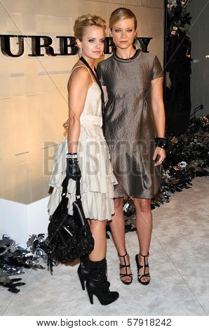 Mena Suvari and Amy Smart  at the Burberry Beverly Hills Store Re-Opening. Burberry Beverly Hills Store, Beverly Hills, CA. 10-20-08