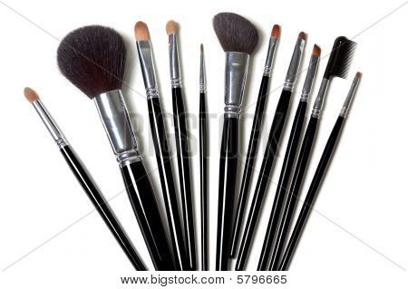Five different makeup brushes isolated on white poster