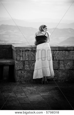 Young Woman Standing At The Railing