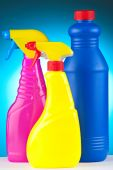 A colourful collection of bottles of janitorial supplies on a blue background poster
