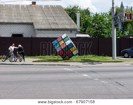 GOMEL, BELARUS - MAY 14, 2014: Rubik's Cube as a monument on a city street. Rubik's Cube is a 3-D combination puzzle invented in 1974 by Hungarian sculptor and professor of architecture Erno Rubik.