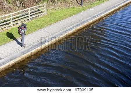 Photographer On Riverside