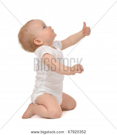 Infant Child Baby Toddler Smiling With Hand Thumb Up Sign