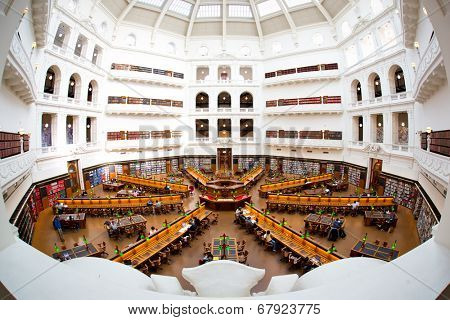 MELBOURNE - July 3, 2014: La Trobe reading room at the State Library of Victoria in Melbourne. The library holds over 2 million books.  It is the central library of the state of Victoria, Australia.