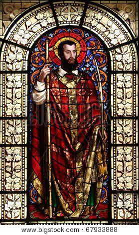 PARIS, FRANCE - NOV 10, 2012: Saint Dionysius, stained glass, Saint-Vincent-de-Paul Church (design Jean-Baptiste Lepere, was built during 1824 - 1844) dedicated to Saint Vincent de Paul