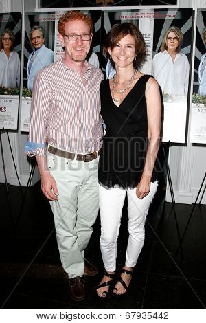 EAST HAMPTON, NEW YORK-JULY 6: Artist Toni Ross (R) and Ron Kaplan attend the premiere of