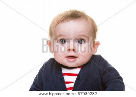 Happy Smiling Baby Girl In Blue Cardigan And Red Striped Top