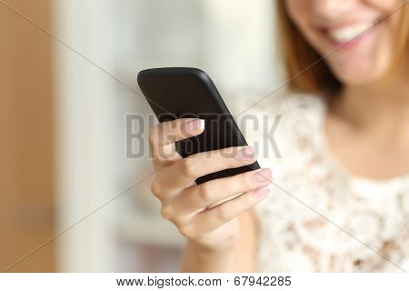 Close Up Of A Woman Hand Using A Smart Phone At Home