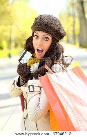 Amazed Woman With Shopping Bags And Credit Card