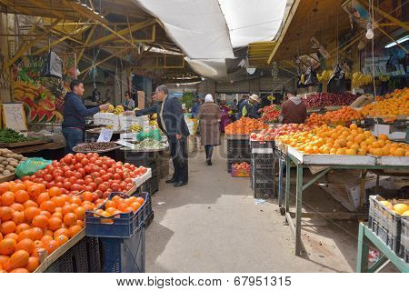 AMMAN, JORDAN - MARCH 17, 2014: People on the farmer's market in the center of Amman. This market is closest to the citadel and amphitheater