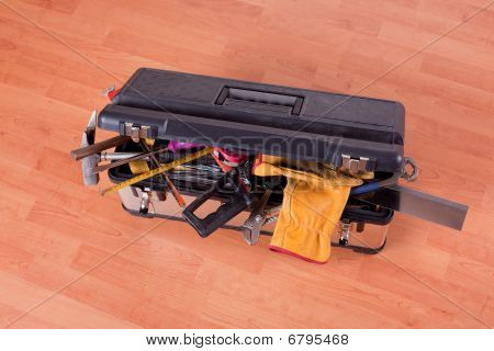 the tools in tool box on wooden floor poster