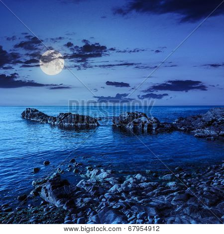 Calm Sea Wave Wash Boulders At Night