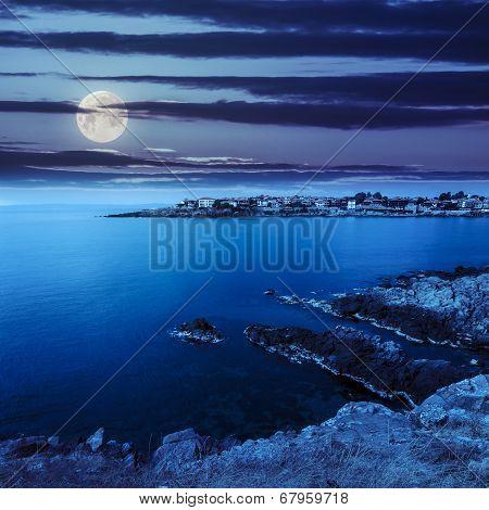 Ancient City On A Rocky Shore Near Sea At Night