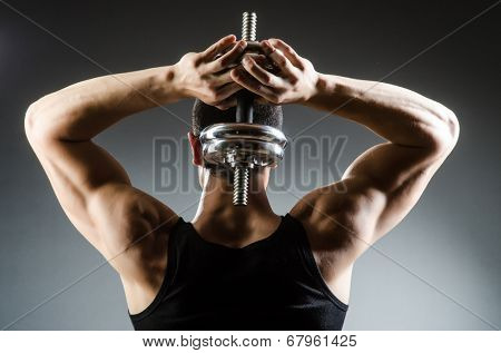 Muscular ripped bodybuilder with dumbbells poster