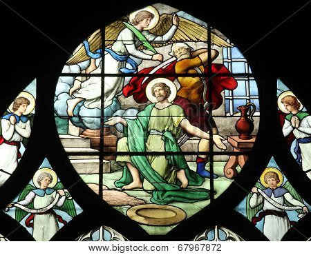 PARIS, FRANCE - NOV 11, 2012: Beheading of John the Baptist, stained glass.The Church of St Severin is Catholic church in the Latin Quarter. It is one of the oldest churches on the Left Bank.