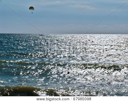 Parachutists over the sea