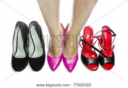 Women's Legs In Pink Shoes, On White Background