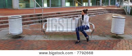 Woman sitting on a brench